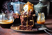 Brownies with salted caramel sauce and ice cream