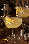 Cardamom spiced pear Martini with pear and lemon garnish