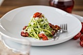 Pasta with pesto, parmesan and grilled tomatoes