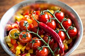 Tomatoes and chillies on chopped peppers