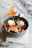 Hearty oat flakes bowl with fruits, goat cheese and thyme
