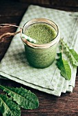 Green smoothie with dandelion, banana and apple juice
