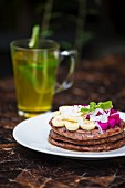 Plate of glutenfree pancakes with dragonfruit and banana slices