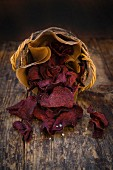 Basket of vegan beetroot chips with fleur de sel