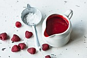 Raspberry coulis with icing sugar