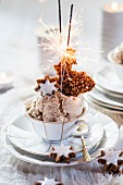 Tea cup of cinnamon star ice cream with caramelized nuts