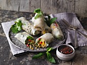 Vegan summer rolls with peanut and chilli dip