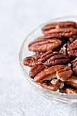 Pecan nuts in a glass bowl