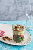 Lamb's lettuce with gorgonzola, pear and walnuts in a glass jar