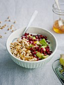 Three-grain muesli with popped spelt, Granny Smith apple and pomegranate seeds