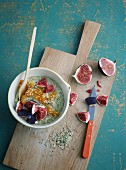 Green millet porridge with fresh figs and wheatgrass powder