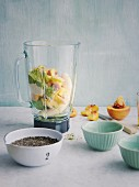 Ingredients for green matcha and peach pudding with avocado in a mixer