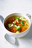 Clear vegetable broth with vegetables