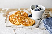 Coconut pancakes with blueberry and coconut yoghurt
