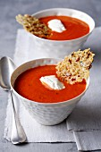 Red pepper and tomato soup with parmesan chips