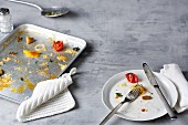 Leftovers on a plate and baking tray
