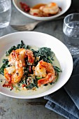 Chilli and lemon prawns on a bed of creamy spinach