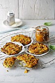 Courgette and parmesan fritters with red pesto