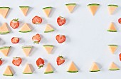Halved strawberries and melon triangles