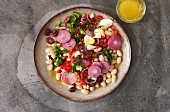 White bean salad with red pepper and red onion