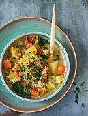Unripe spelt grain and potato stew with carrot and leek