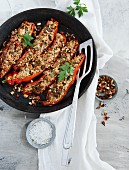 Pointed peppers filled with buckwheat and cream cheese and topped with oven-roasted chilli almonds