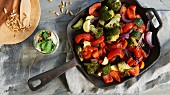 Colourful oven-roasted vegetables and a yoghurt and mint sauce