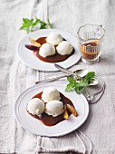 Marzipan ice cream with plum and cinnamon sauce