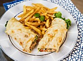 Chicken and vegetable wraps with French fries