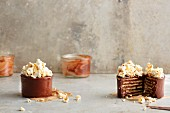 Layered chocolate biscuit cakes topped with popcorn