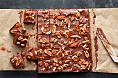 Chocolate and caramel fudge with pecan nuts