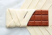 A bar of chocolate wrapped in ready-made flaky pastry