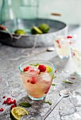 Homemade lemonade with raspberries in glasses