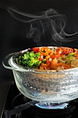 Steamed vegetables in a steamer
