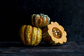 Three heirloom pumpkins, whole and halved