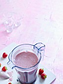 Strawberry Dream with banana, chia seeds and coconut milk in a mixer