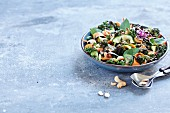 Kale and courgette salad with wasabi shoots and cashews