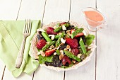 Strawberry and asparagus salad with almond flakes and strawberry dressing
