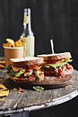 Sandwiches with avocado, tortilla chips and redcurrant salsa