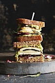 A spelt bread sandwich with courgette cream, crispy tofu and sage