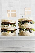 Swedish club sandwiches with liquorice, smoked trout mousse and blueberries
