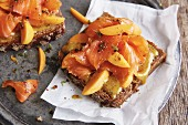 Wholemeal bread with pickled salmon, fresh apricots and honey mustard