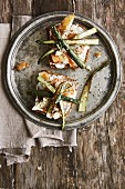 Wholemeal bread with smoked ocean perch, soft goat's cheese and green asparagus