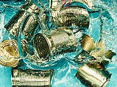Tin cans falling into water