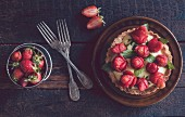 A homemade tart with strawberries and vanilla pudding
