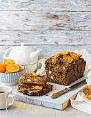 A pumpkin and date loaf with clementines