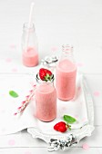 Strawberry smoothie in bottles