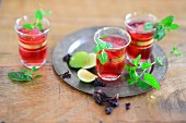 Icy cold hibiscus and mint tea with lime juice
