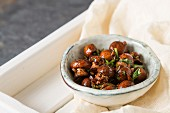 Fried mushrooms cooked with Italian herbs in a ceramic bowl