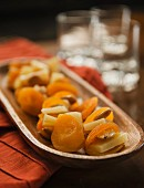 Dried apricots with cheese and almonds in a wooden bowl (appetisers)